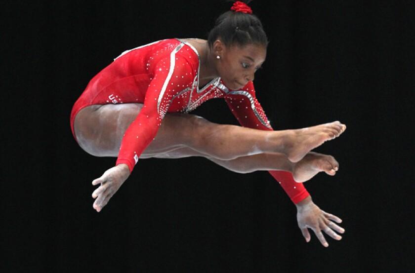 Simone Biles performs her routine on the balance beam Wednesday.