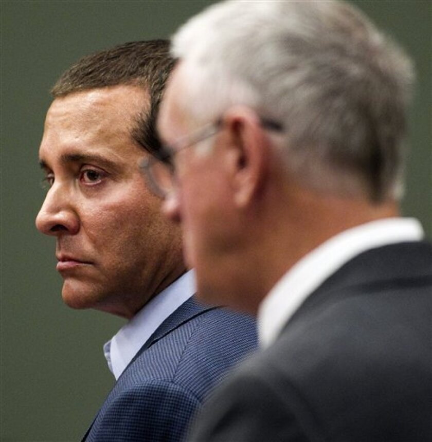 James Arthur Ray, left, and his attorney, Thomas Kelly, right, stand in the courtroom of Judge Warren R. Darrow, in the Yavapai County Courthouse in Camp Verde, Ariz., Wednesday, June 22, 2011. Ray, the self-help author who led a deadly sweat lodge ceremony in Arizona in 2009, was found guilty of three counts of negligent homicide. (AP Photo/Tom Tingle, Pool)