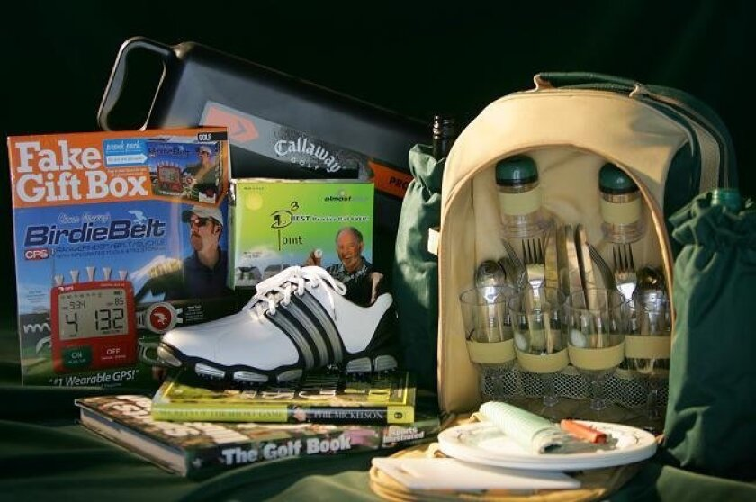 Gifts for golfers: The Fake Gift Box is just that, a box advertising a ridiculous golf device while holding the real gift inside. The Golf Caddy from Callaway Golf dispenses a golf ball with a tap from your club so you don't have to bend over to pick up balls. The golf picnic back pack can hold two
