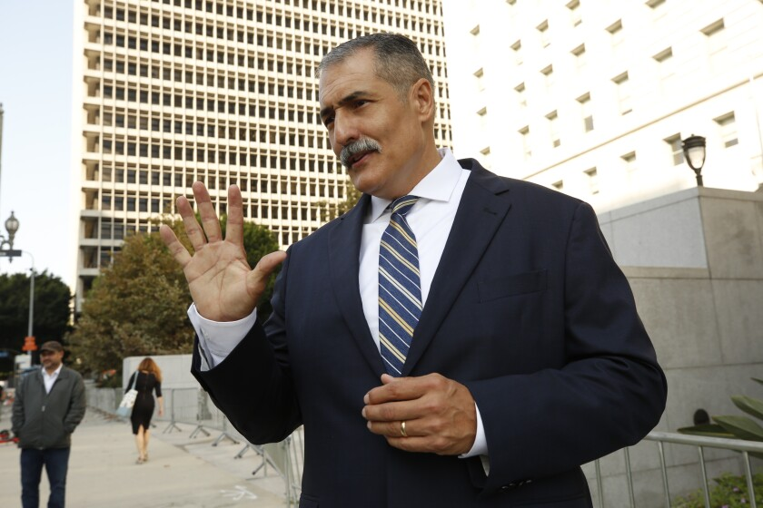 Los Angeles County Sheriff's commander Eli Vera held a press conference in front of the Hall of Justice