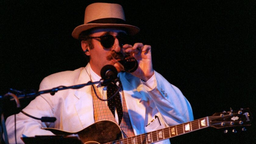 Leon Redbone takes a drink in between songs while performing Thursday night at the Coach House in