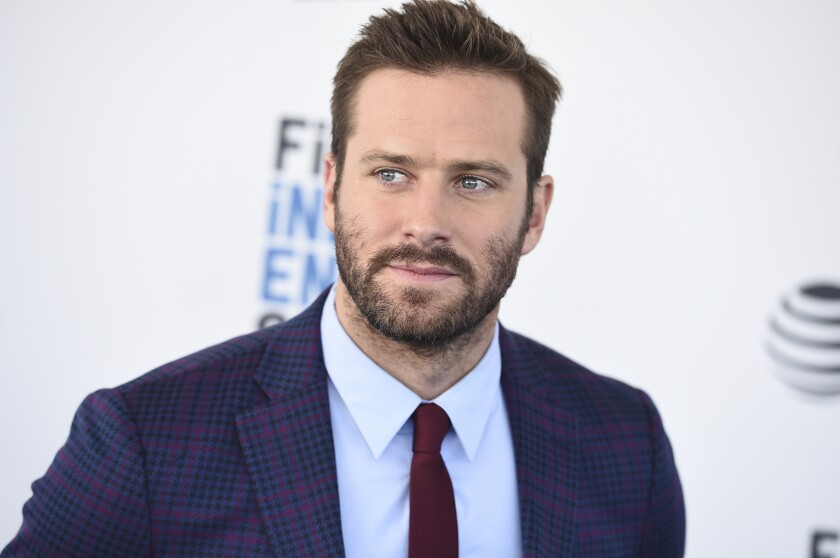 Armie Hammer in a suit and tie