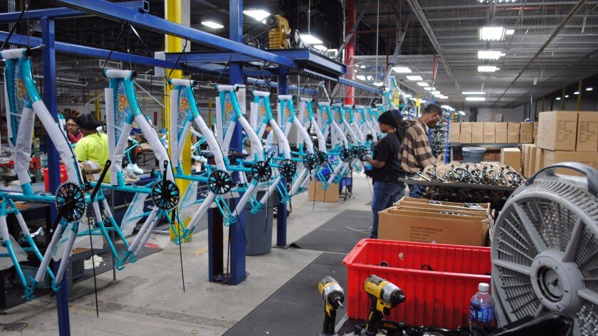 Workers at Bicycle Corporation of America assemble bikes for Wal-Mart, Target and other retailers