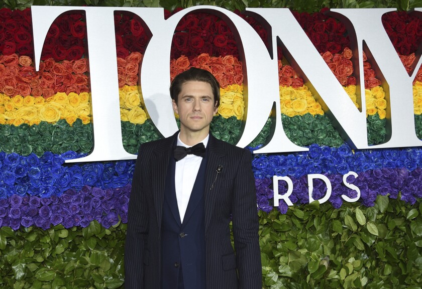 """FILE - Aaron Tveit arrives at the 73rd annual Tony Awards in New York on June 9, 2019. Tveit is the only actor nominated in the category of best leading actor in a musical for his role in """"Moulin Rouge! The Musical."""" (Photo by Evan Agostini/Invision/AP, File)"""