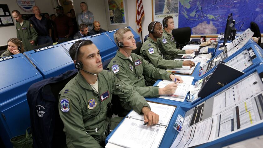 Members of the Air Force 576th Flight Test Squadron launch team for GT-222 monitor systems from the