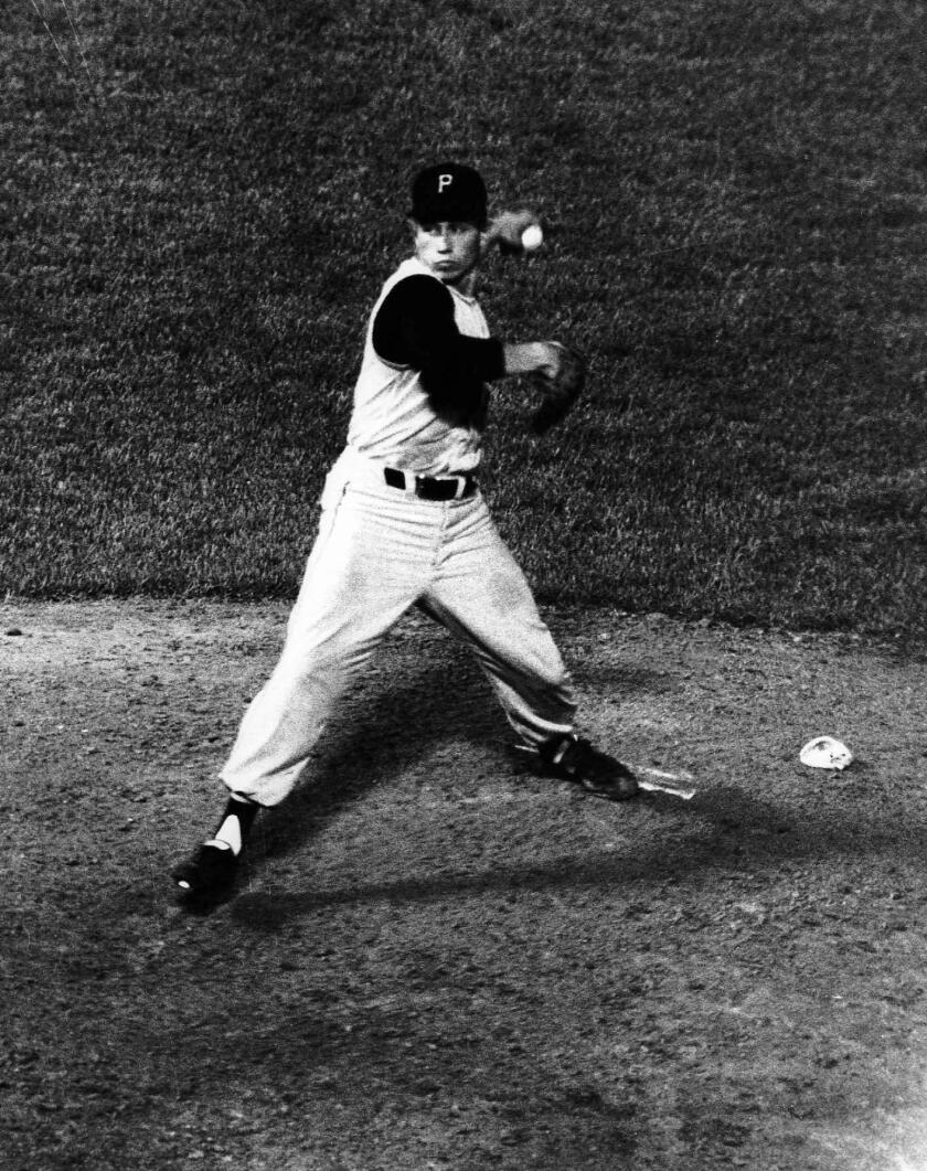 Pittsburgh Pirates pitcher Harvey Haddix throws during one of his 12 perfect innings against the Milwaukee Braves on May 26, 1959, in Milwaukee. Haddix was perfect through 12 but ended up losing the game in the 13th, 1-0.