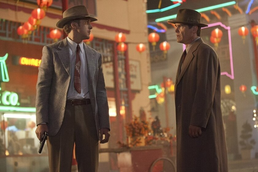 "Josh Brolin (right) and Ryan Gosling (left) stare each other down in Chinatown in the new movie ""Gangster Squad."""