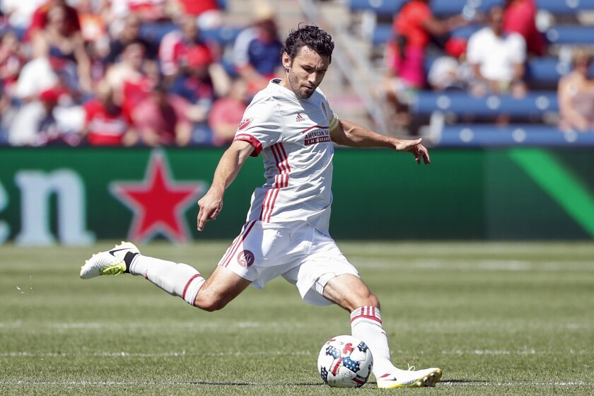 FILE - In this June 10, 2017, file photo, Atlanta United defender Michael Parkhurst is shown in action against the Chicago Fire during the first half of an MLS soccer match, in Bridgeview, Ill. Atlanta United captain Michael Parkhurst will retire at the end of the season. Parkhurst announced his decision Monday, Sept. 23, 2019, before the team trained for a crucial match at New York City FC. (AP Photo/Kamil Krzaczynski, File)