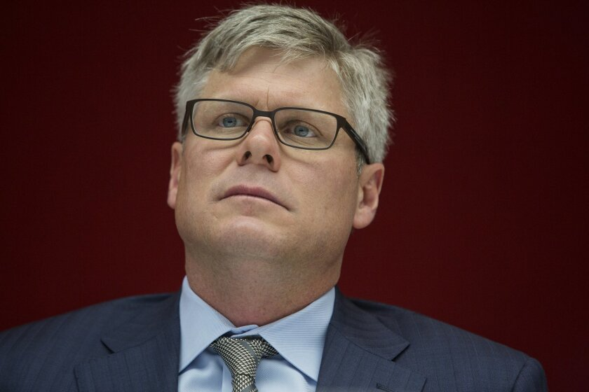 Steven Mollenkopf, chief executive officer of Qualcomm Inc., listens during an interview in New York, U.S., on Thursday, March 12, 2015. Mollenkopf's first year at the helm of Qualcomm Inc., the chipmaker disclosed regulatory investigations in China and the U.S., lamented licensees that failed to p