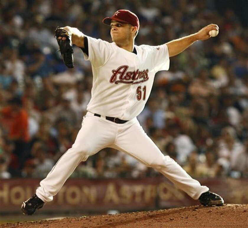 The Houston Astros' Wandy Rodriguez delivers a pitch during the third inning of their baseball game against the Chicago Cubs Saturday, July 19, 2008 in Houston, Texas. (AP Photo/Dave Einsel)