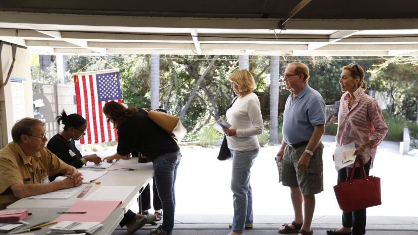 Voters crowd the garage of a home in Sherman Oaks to vote in the June 07, 2016 California primary.