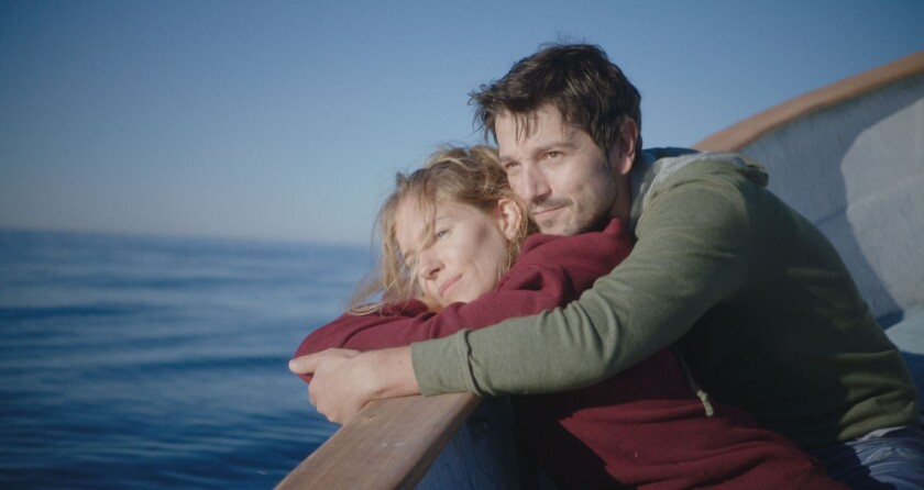 """Sienna Miller and Diego Luna in the movie """"Wander Darkly,"""" a story of shifting truths and perspectives."""