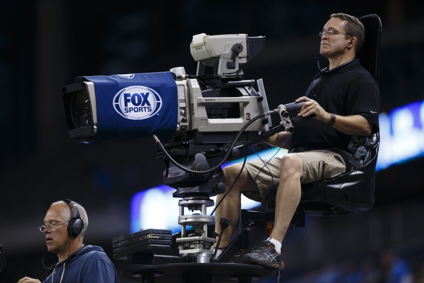 Fox Sports camera crew is seen during an NFL football game in Detroit last year.