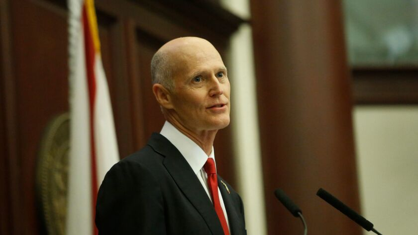 The office of Gov. Rick Scott says he will continue to defend Florida's system for determining whether felons can have their voting rights restored.