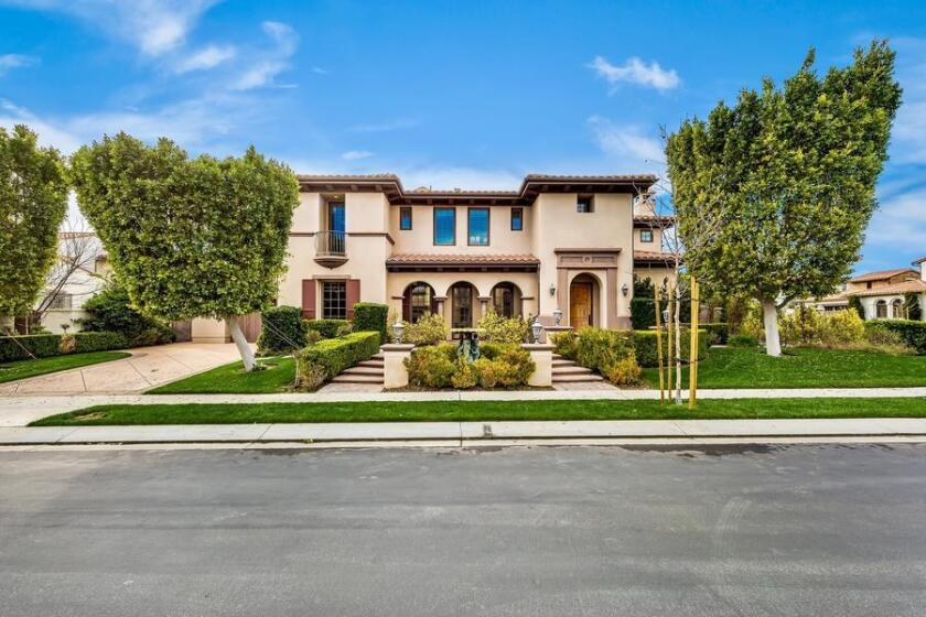 The five-bedroom, six-bathroom house sits on a corner lot in a gated Calabasas community.