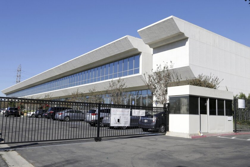 This Friday, Nov. 6, 2015 photo shows the Faraday Future building in Gardena, Calif. Faraday Future has been hunting for a place to build what it says will be a $1 billion manufacturing plant for a new line of cars. Four states are contenders and the company says to expect an announcement within we