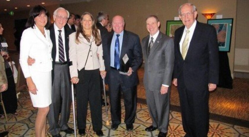 At the Aviation Week awards ceremony, from left, Kathy Hedges, SAIC director of program execution, is joined by her husband Russ Loftman, SAIC consultant on 3GIRS/CHIRP; and Amelia Opean, of SAIC's program execution office and technical writer for 3GIRS/CHIRP nomination; Tom Taverney, SAIC director