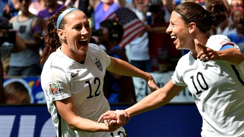 Lauren Holiday, left, and Carli Lloyd celebrate after a U.S. goal against Japan during the 2015 World Cup final.