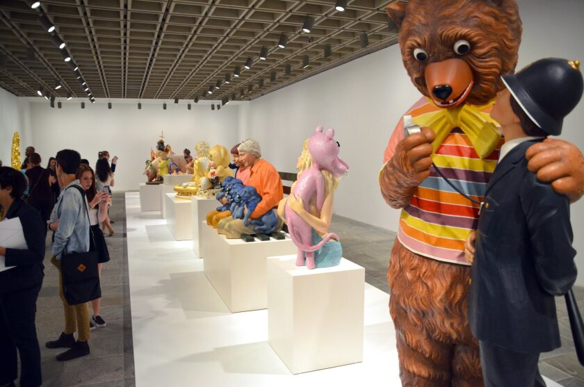 """Sculptures by artist Jeff Koons on display in the exhibition """"Jeff Koons: A Retrospective"""" at the Whitney Museum of American Art in New York."""