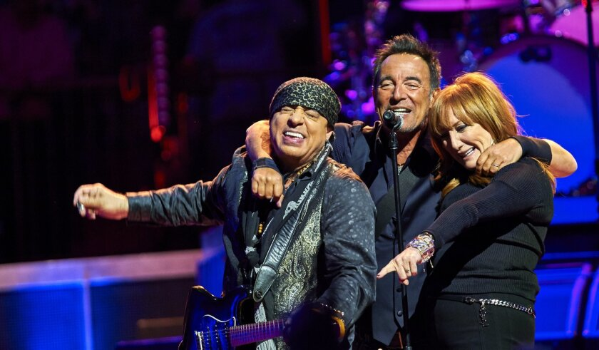 Bruce Springsteen, center, Stevie Van Zandt, left, and Patti Scialfa perform with the E Street Band at Madison Square Garden, Wednesday, Jan. 27, 2016, in New York. (Photo by Robert Altman /Invision/AP)