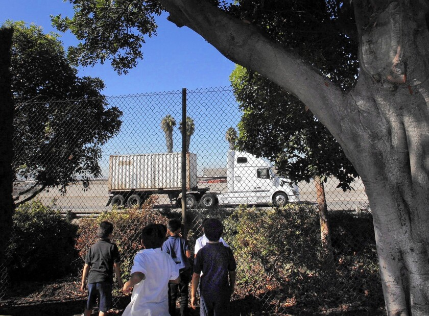 Children at Hudson Elementary School have a view of the 103 Freeway in Long Beach, one of several U.S. cities that are considering doing away with urban stretches of freeway to create more livable space.