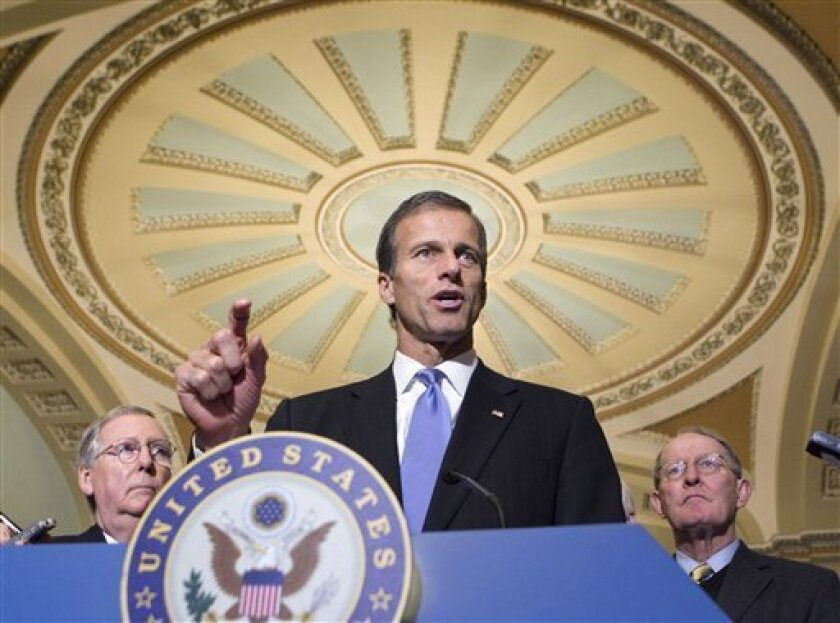 FILE - In this Feb. 8, 2011 file photo, Sen. John Thune, R-S.D. speaks on Capitol Hill in Washington. Thune has declined to pursue a bid for president next year. He is joined by Senate Minority Leader Mitch McConnell of Ky., left, and Sen. Lamar Alexander, R-Tenn. (AP Photo/J. Scott Applewhite, File)