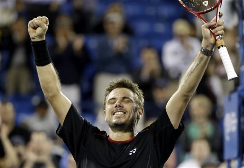 Stanislas Wawrinka, of Switzerland, celebrates after defeating Tomas Berdych, of the Czech Republic, in the fourth round of the U.S. Open tennis tournament, Tuesday, Sept. 3, 2013, in New York. (AP Photo/David Goldman)