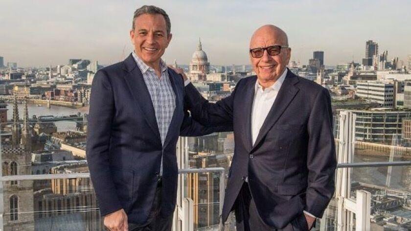 Disney CEO Bob Iger, left, and Fox controlling stockholder Rupert Murdoch.