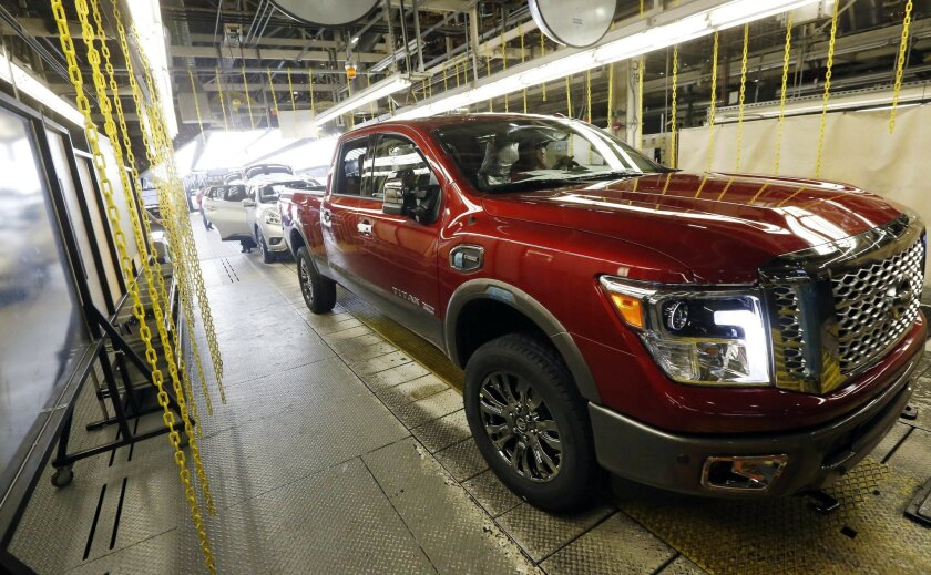 In this April 6, 2016, photo, a newly completed Titan rolls off the line at the Nissan Canton Vehicle Assembly Plant in Canton, Miss. America's love of trucks and SUVs helped push most automakers to healthy sales gains in April 2016 as Honda and Nissan reported best-ever April sales. Ford posted re