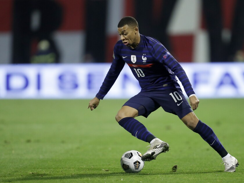 France's Kylian Mbappe controls the ball during the UEFA Nations League soccer match between Croatia and France at Maksimir Stadium in Zagreb, Croatia, Wednesday, Oct. 14, 2020. (AP Photo/Darko Bandic)