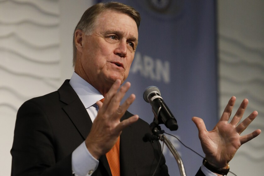 FILE - In this Aug. 6, 2019, file photo, Sen. David Perdue, R-Ga., speaks during a Kiwanis Club of Atlanta luncheon. Campaign finance disclosures show that Georgia's incumbent Republican U.S. senators have built a healthy fundraising advantage over their rivals in the state's dual Senate races. (AP Photo/Andrea Smith, File)