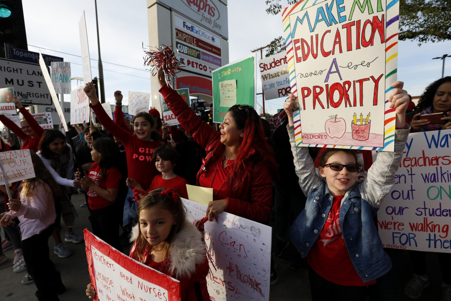 Parents, teachers, and students rally in support of teachers at the corner of Topanga Canyon and Ventura Blvd. in Woodland Hills.