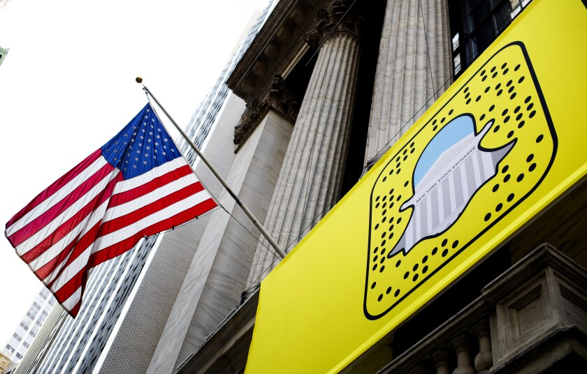 A logo for Snapchat hangs on the front of the New York Stock Exchange.