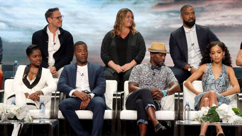 "At the TCA press tour for ""All American"" are, back row from left, Greg Berlanti, April Blair and Spencer Paysinger, and bottom row from left, Bre-Z, Daniel Ezra, Taye Diggs and Samantha Logan."