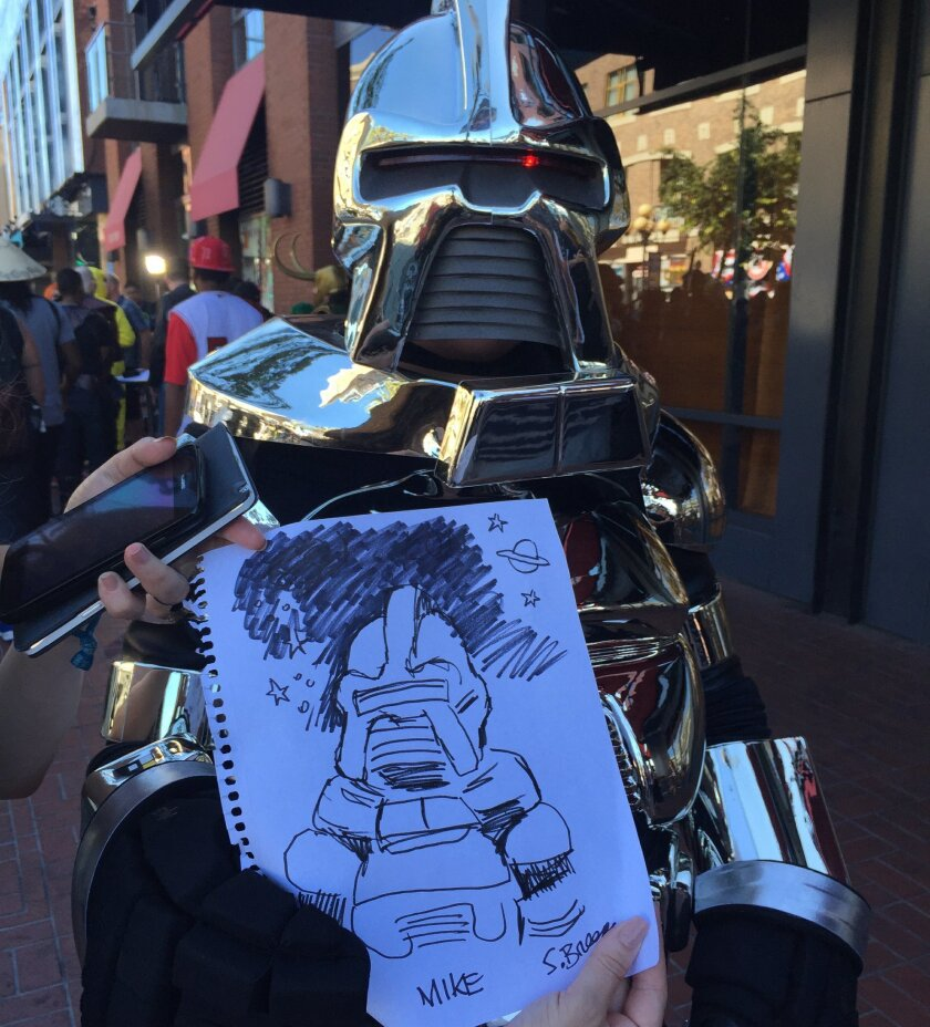 Union-Tribune editorial cartoonist Steve Breen draws up a Cylon from Battlestar Galactica.