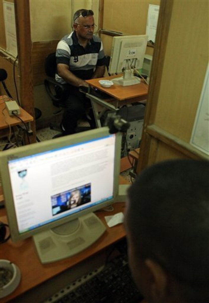 Iraqi people surf the internet for WikiLeaks web site in Baghdad, Iraq, Saturday, Oct. 23, 2010. Military documents laid bare in the biggest leak of secret information in U.S. history suggest that far more Iraqis died than previously acknowledged during the years of sectarian bloodletting and crimi