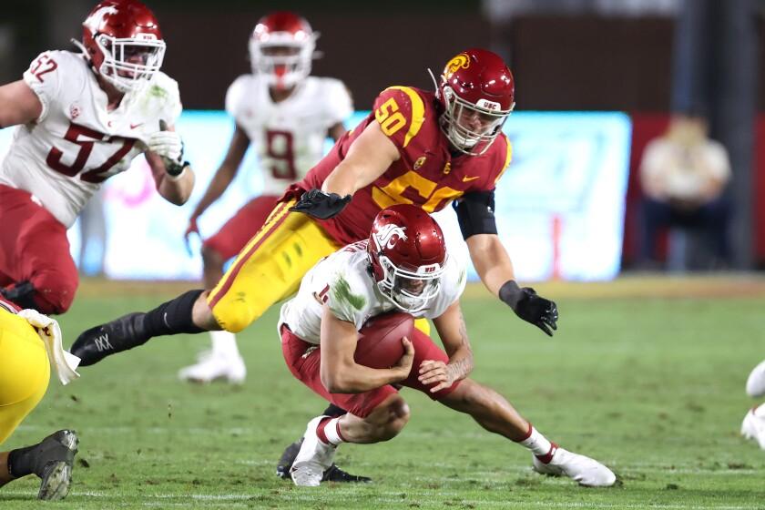 USC's Nick Figueroa sacks Washington State quarterback Jayden de Laura.