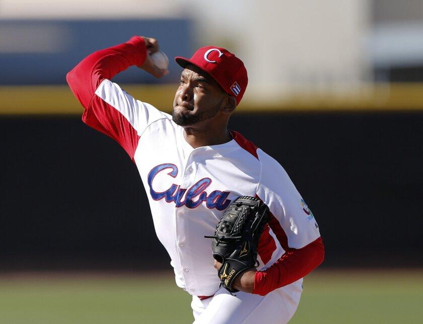 Odrisamer Despaigne, a Cuban pitcher, works out for major league scouts.