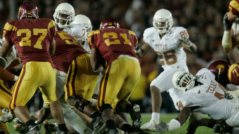 The Texas defense stops USC's LenDale White on fourth and two.