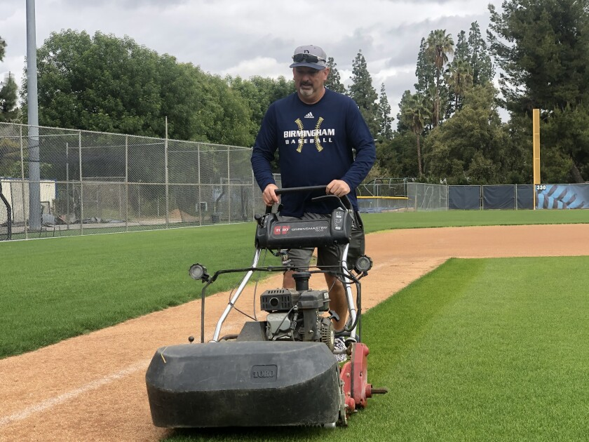 Birmingham baseball coach Matt Mowry has plenty of free time to mow the infield.