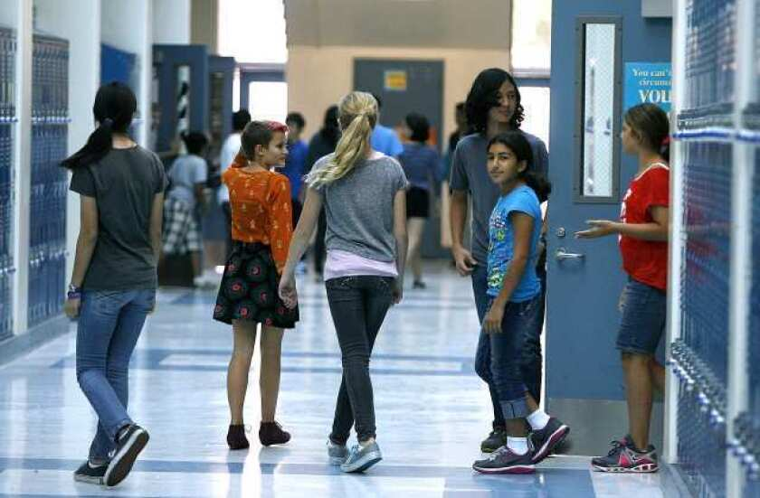 Cuts to local schools loom, but Prop. 30 passage 'doesn't make it any worse'