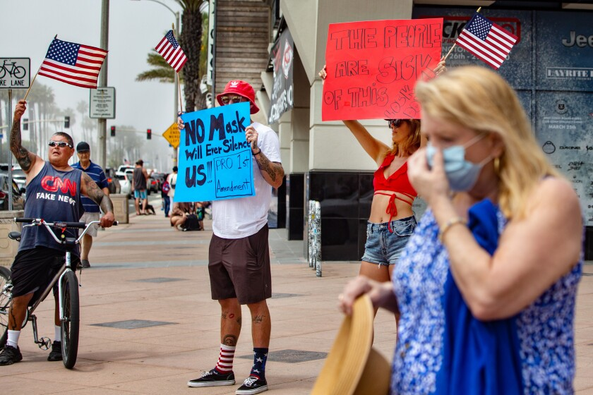 Demonstrators protest California lockdown at Huntington Beach