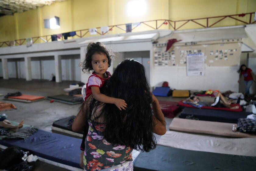 Clementa Perez and her two children sleep on mattresses on the floor at the Hijo Prodigo shelter in Mexicali, Mexico.