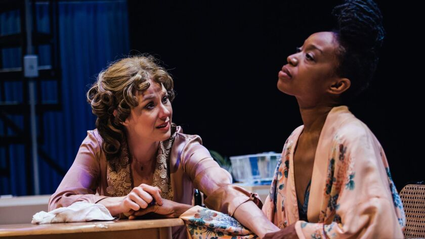 "Jaimi Paige, left, and Maya Lynne Robinson in a scene from Boston Court's ""Streetcar Named Desire."""