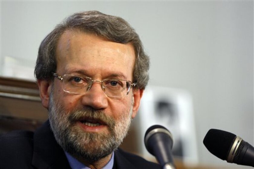 Iranian parliament speaker Ali Larijani speaks with media, during his press conference in the parliament, in Tehran, Iran, Monday, Nov. 30, 2009. Iran approved plans Sunday to build 10 industrial scale uranium enrichment facilities, a dramatic expansion of the program in defiance of U.N. demands it