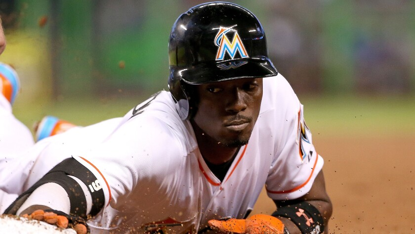 Miami Marlins second baseman Dee Gordon slides safely back to first during a game against the New York Mets on April 29.