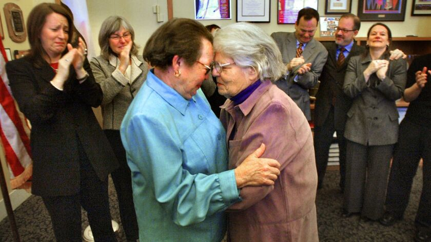 Phyllis Lyon, left, and Del Martin, longtime lesbian activists, embrace after their marriage at City Hall in San Francisco on Thursday, Feb. 12, 2004.