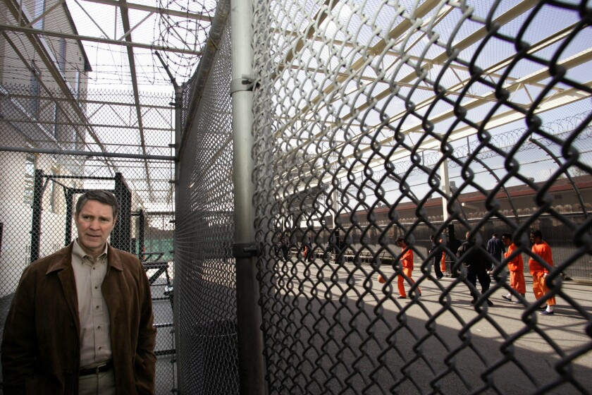 Former U.S. Senate Majority Leader Bill Frist, R-Tenn., stands next to a recreation area for immigrant detainees, while touring the San Pedro Service Processing Center on Terminal Island in Los Angeles on February 21, 2006.