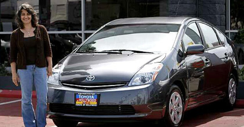 It could take a month, but Anna Gladstone of Hollywood Hills put a deposit down on a Prius at Toyota of Hollywood. The gas-electric car averages 46 miles per gallon. Gladstone is canceling the lease on her Volvo Cross Country.