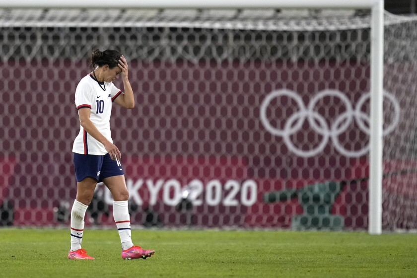 United States' Carli Lloyd leaves the field after being defeated 1-0 by Canada during a women's semifinal soccer match at the 2020 Summer Olympics, Monday, Aug. 2, 2021, in Kashima, Japan. (AP Photo/Andre Penner)